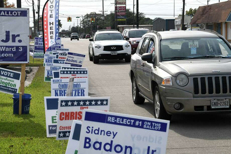Campaign signs line part of 39th Street in Groves on Election Day. Photo taken Tuesday, 11/5/19 Photo: Guiseppe Barranco/The Enterprise, Photo Editor / Guiseppe Barranco ©