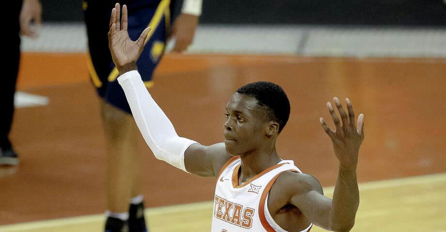 Texas guard Andrew Jones gestures to the crowd during the team's NCAA college basketball game against Northern Colorado on Tuesday, Nov. 5, 2019, in Austin, Texas. (Nick Wagner/Austin American-Statesman via AP) Photo: Nick Wagner/Associated Press
