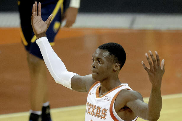 Texas guard Andrew Jones gestures to the crowd during the team's NCAA college basketball game against Northern Colorado on Tuesday, Nov. 5, 2019, in Austin, Texas. (Nick Wagner/Austin American-Statesman via AP)
