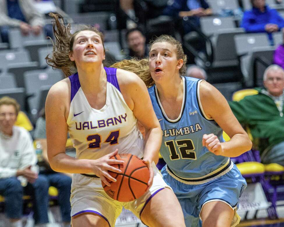 UAlbany center Alexi Schecter drives by Columbia forward Hannah Pratt during the UAlbany season opener against Columbia at the SEFCU Arena on Tuesday, Nov. 5, 2019 (Jim Franco/Special to the Times Union.)
