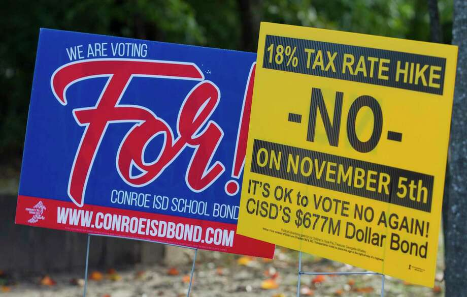 Political signs for and against the $677.38 million Conroe ISD bonds are seen at the South Montgomery County Community Center on Election Day, Tuesday, in The Woodlands. Photo: Jason Fochtman, Houston Chronicle / Staff Photographer / Houston Chronicle