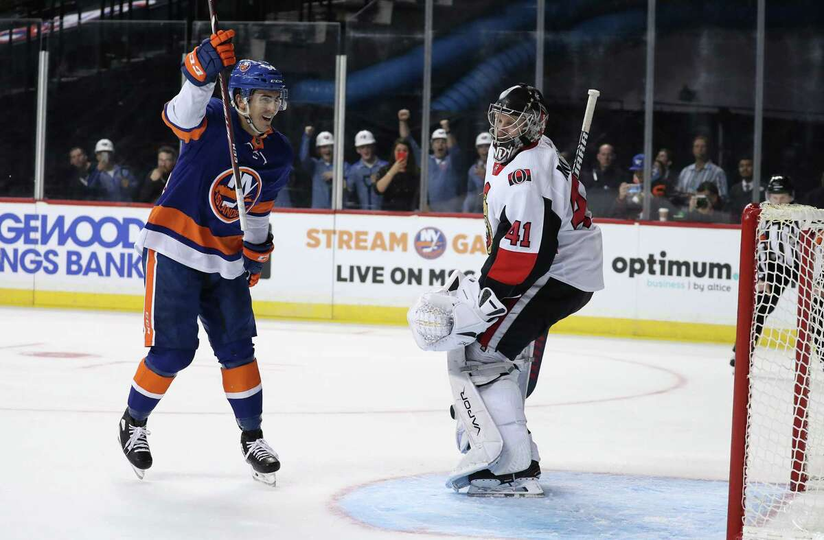 NEW YORK, NEW YORK - NOVEMBER 05: Cole Bardreau #34 of the New York Islanders celebrates scoring his first NHL goal in the second period against Craig Anderson #41 of the Ottawa Senators during their game at Barclays Center on November 05, 2019 in New York City. (Photo by Al Bello/Getty Images)