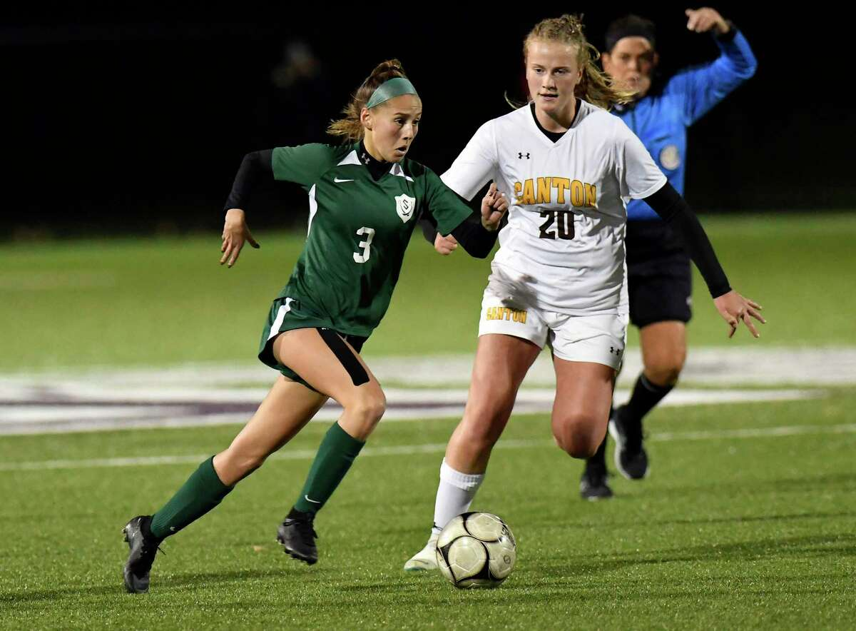 Schalmont's Ashley Cirilla(3) moves the ball past Canton's Amelia Rodee (20) during the first half of a girlsA?• Class B State sub regional high school soccer game Tuesday, November 5, 2019, in Troy, N.Y. Schalmont won the game 4-0. (Hans Pennink / Special to the Times Union)