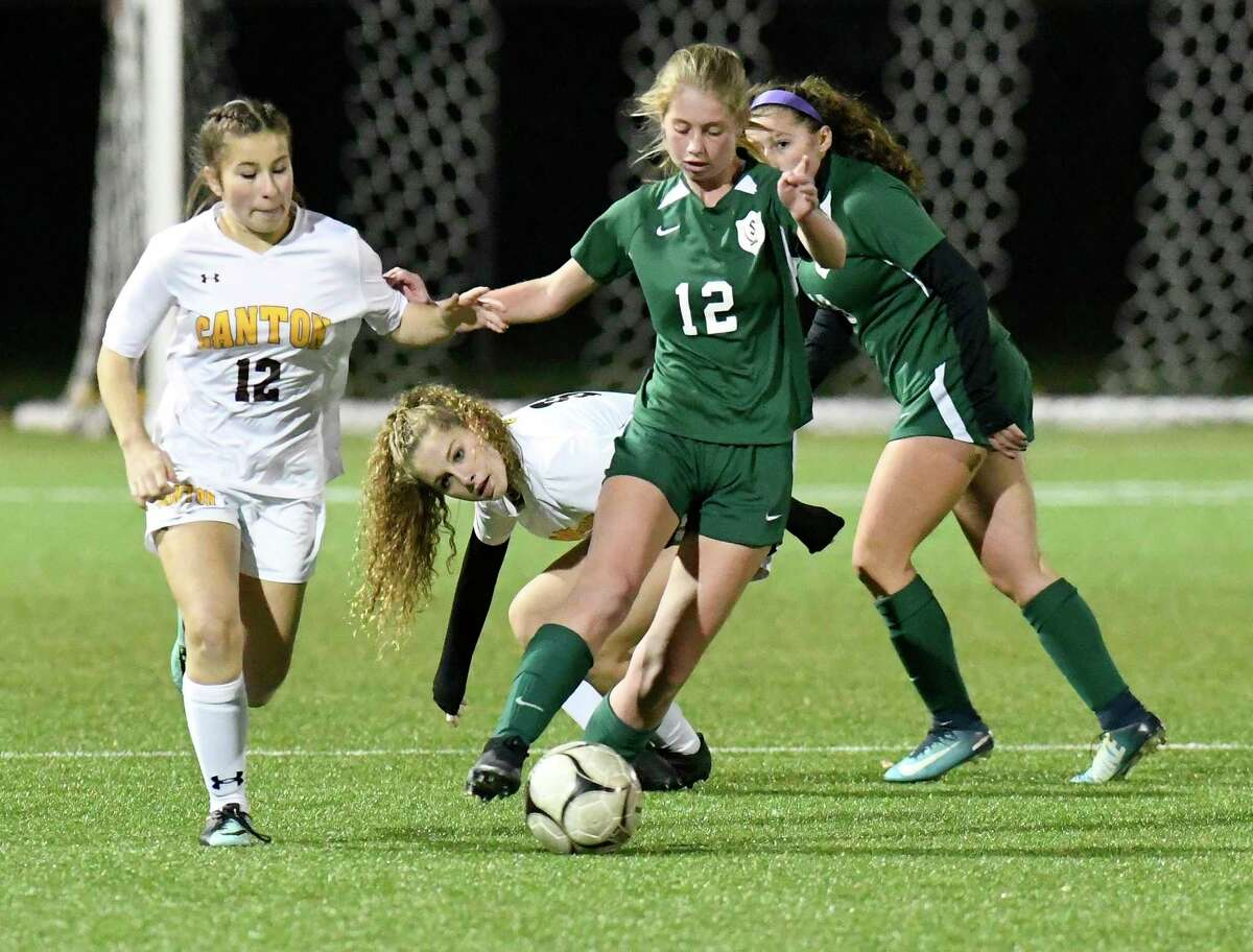 Schalmont's Teghan Older (12) moves the ball against Canton defenders during the first half of a girlsA?• Class B State sub regional high school soccer game Tuesday, November 5, 2019, in Troy, N.Y. Schalmont won the game 4-0. (Hans Pennink / Special to the Times Union)