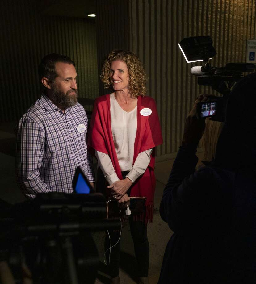 David Joyner and Christine Foreman talk to the media about the early numbers for the MISD bond Tuesday, Nov. 5, 2019 outside the Midland County Annex. Photo: Jacy Lewis/Reporter-Telegram