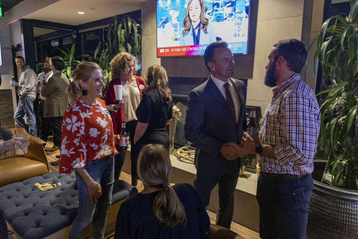Patrick Payton visits for election night party for the MISD bond and shakes Dave Joyner?•s hand Tuesday, Nov. 5, 2019 at Ally Outdoors. Jacy Lewis/Reporter-Telegram
