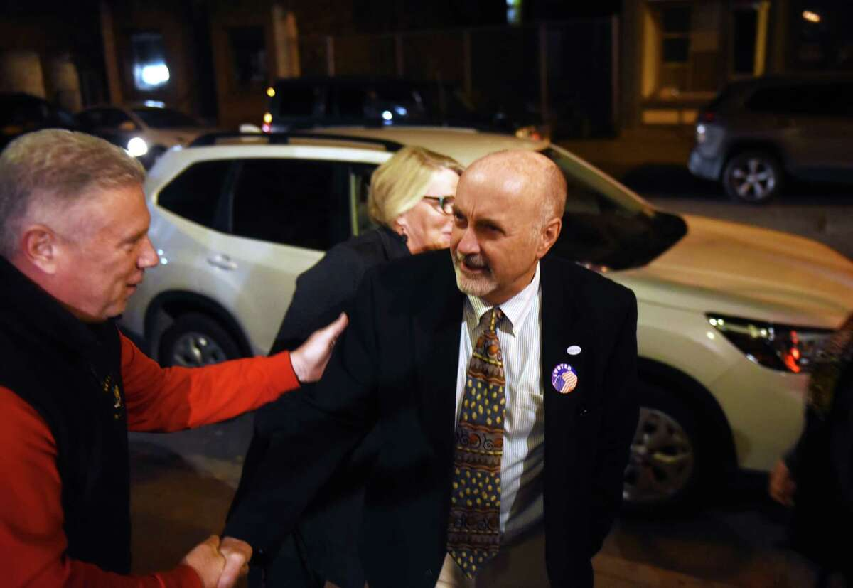 Troy Mayor Patrick Madden is congratulated by Assemblyman John T. McDonald III, left, during Madden's election night party on Tuesday, Nov. 5, 2019, at Ryan's Wake in Troy, N.Y. (Will Waldron/Times Union)