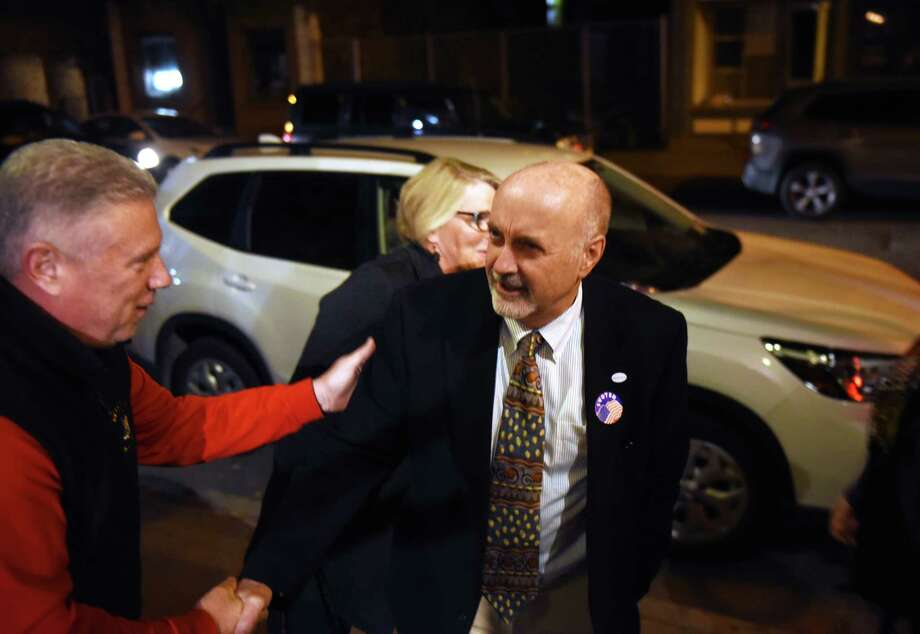 Troy Mayor Patrick Madden is congratulated by Assemblyman John T. McDonald III, left, during Madden's election night party on Tuesday, Nov. 5, 2019, at Ryan's Wake in Troy, N.Y. (Will Waldron/Times Union) Photo: Will Waldron / 40048145A