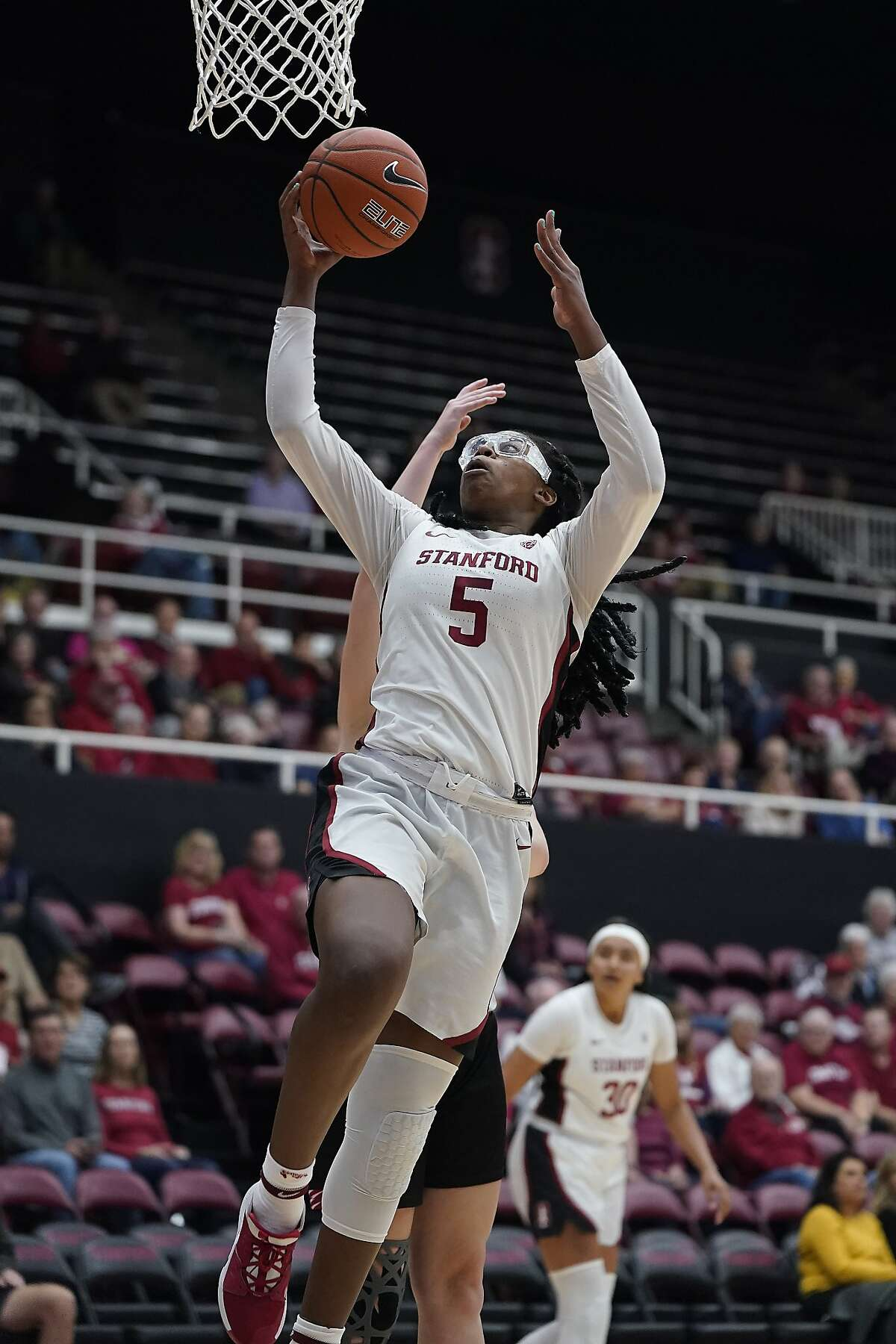 Stanford forward Francesca Belibi (5) lays the ball up against Eastern Washington during the first half of an NCAA college basketball game Tuesday, Nov. 5, 2019, in Stanford, Calif. (AP Photo/Tony Avelar)