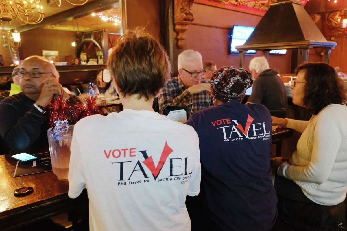 Supporters of District 1 city council candidate Philip Tavel gather at Talarico's Pizza in West Seattle as they wait for the election results to come in, Tuesday, Nov. 5, 2019.