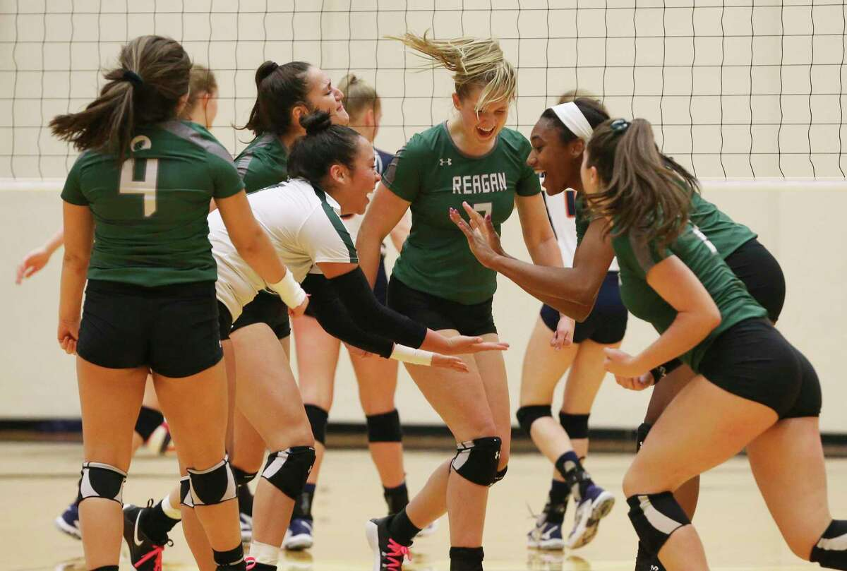 The Reagan volleyball team celebrates after taking a contentious first game against Brandeis in Class 6A bidistrict high school volleyball playoff at Littleton Gym on Tuesday, Nov. 5, 2019. (Kin Man Hui/San Antonio Express-News)