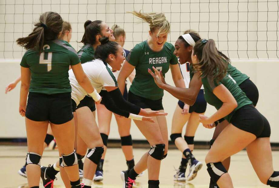 The Reagan volleyball team celebrates after taking a contentious first game against Brandeis in Class 6A bidistrict high school volleyball playoff at Littleton Gym on Tuesday, Nov. 5, 2019. (Kin Man Hui/San Antonio Express-News) Photo: Kin Man Hui, Staff / Staff Photographer / ©2019 San Antonio Express-News
