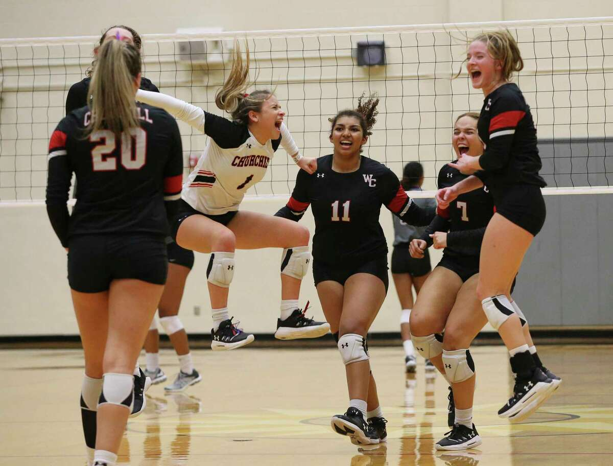 The Churchill volleyball team celebrates the final victorious point against Warren in Class 6A bidistrict high school volleyball playoff at Littleton Gym on Tuesday, Nov. 5, 2019. Churchill routs Warren, 3-0, to take the win. (Kin Man Hui/San Antonio Express-News)