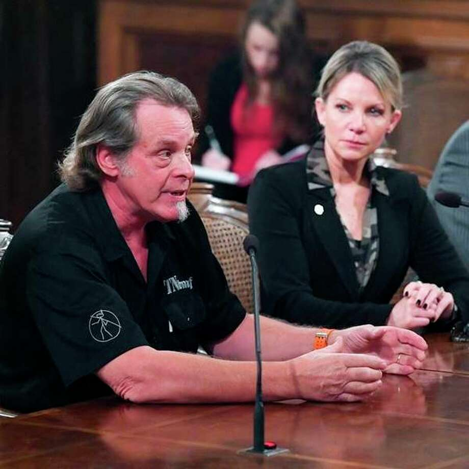 State Rep. Michele Hoitenga, R-Manton, and rocker Ted Nugent, pictured at left, testify Sept. 17 in support of her plan to end the ban on baiting deer in Michigan. (Courtesy photo)