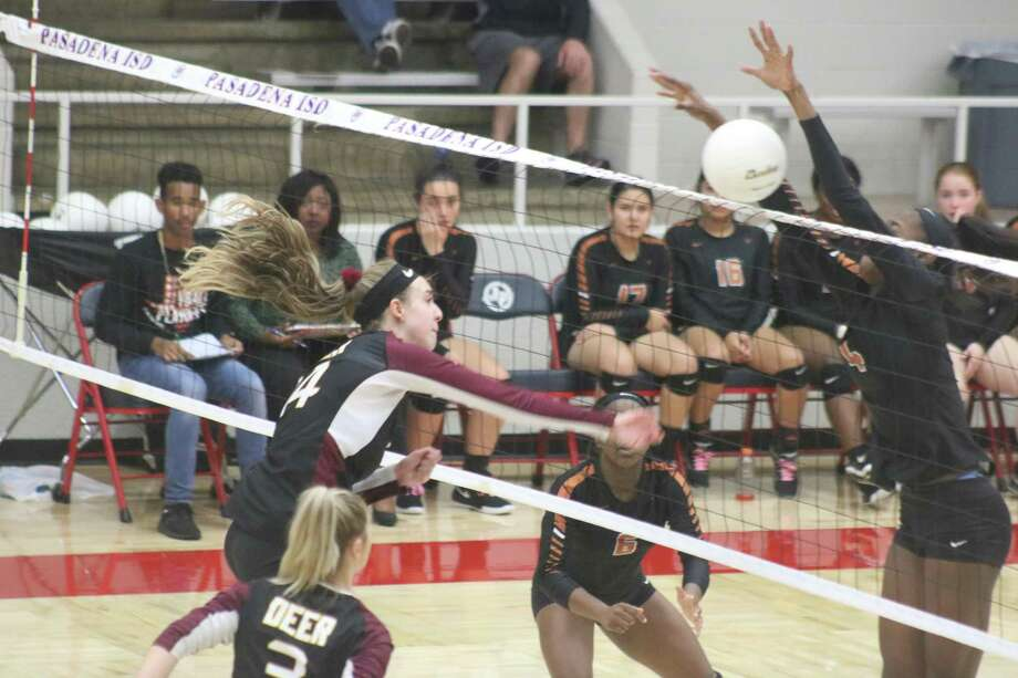 Deer Park's McKenzie Morvant attempts to get a ball past Dobie's line of defense along the net Tuesday night. Photo: Robert Avery
