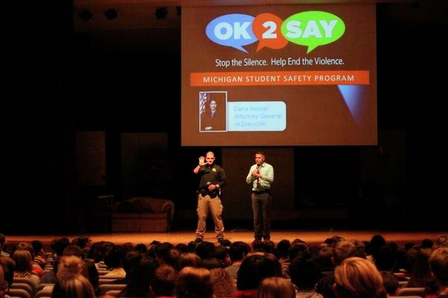 Benzie Central assistant principal Steve Graetz and school resource officer Deputy Geoff Miller talk to students about the OK2Say program. (Photo/Robert Myers)