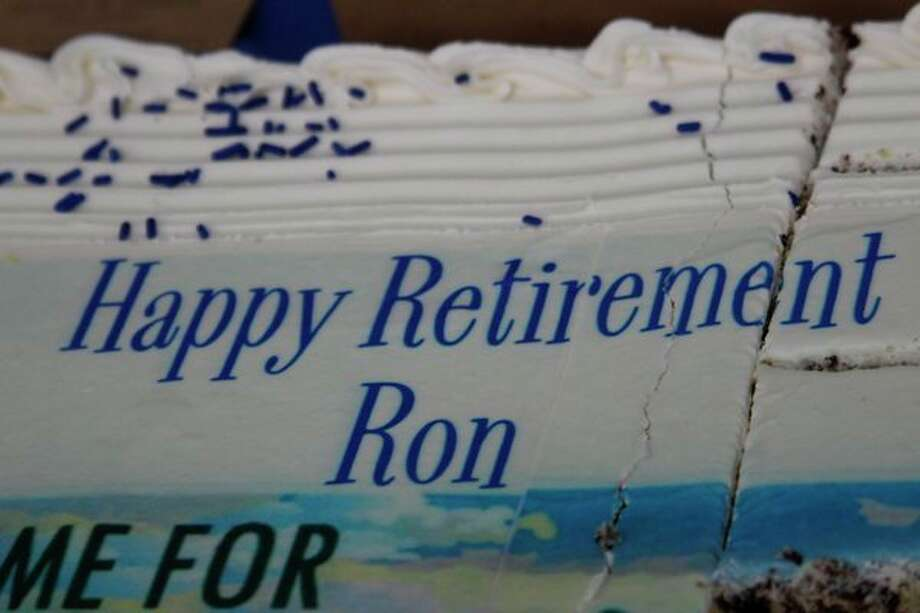 Colleagues and the county provided a personalized cake for Ron Berns' retirement party honoring his 8 years of service as central dispatch director. (Photo/Colin Merry)