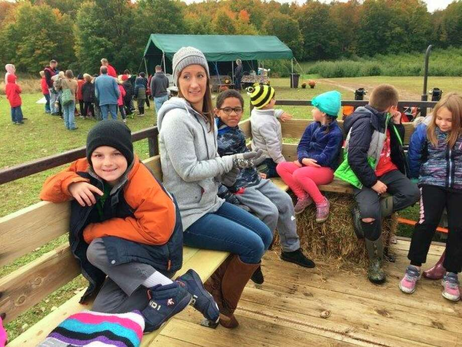Second grade students from Lake Ann Elementary enjoy a tractor ride at Nugent Farms. (Submitted photo)
