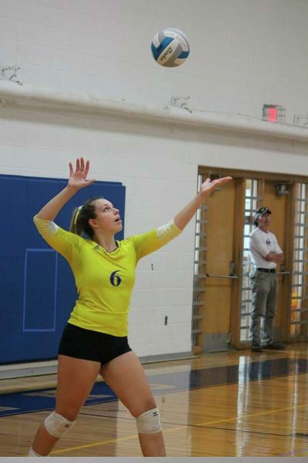 Landrie LaPreze gets ready to serve in a recent Morley Stanwood match. (Pioneer photo/John Raffel)