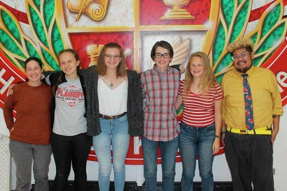 (From left) Benzonia Public Library director Amanda McLaren; students Reeve Katt, Melia Lorenz, Finn McLaren and Au Sable Kreiner; and Benzie Central teacher Ferd De Guia are working together on the oral history project this year. (Photo/Robert Myers)