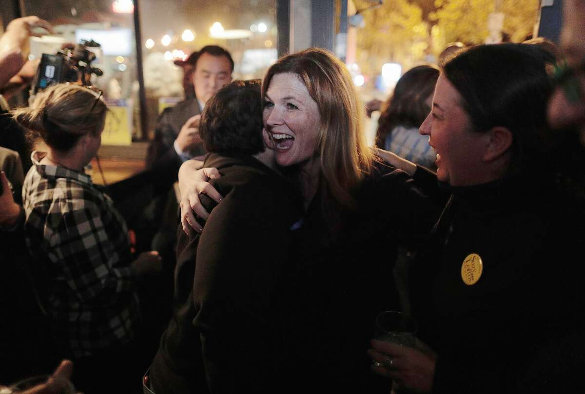 Suzy Loftus, candidate for San Francisco district attorney, hugs supporters at Churchill as she arrives to await results on election night in San Francisco, Calif., on Tuesday, November 05, 2019.