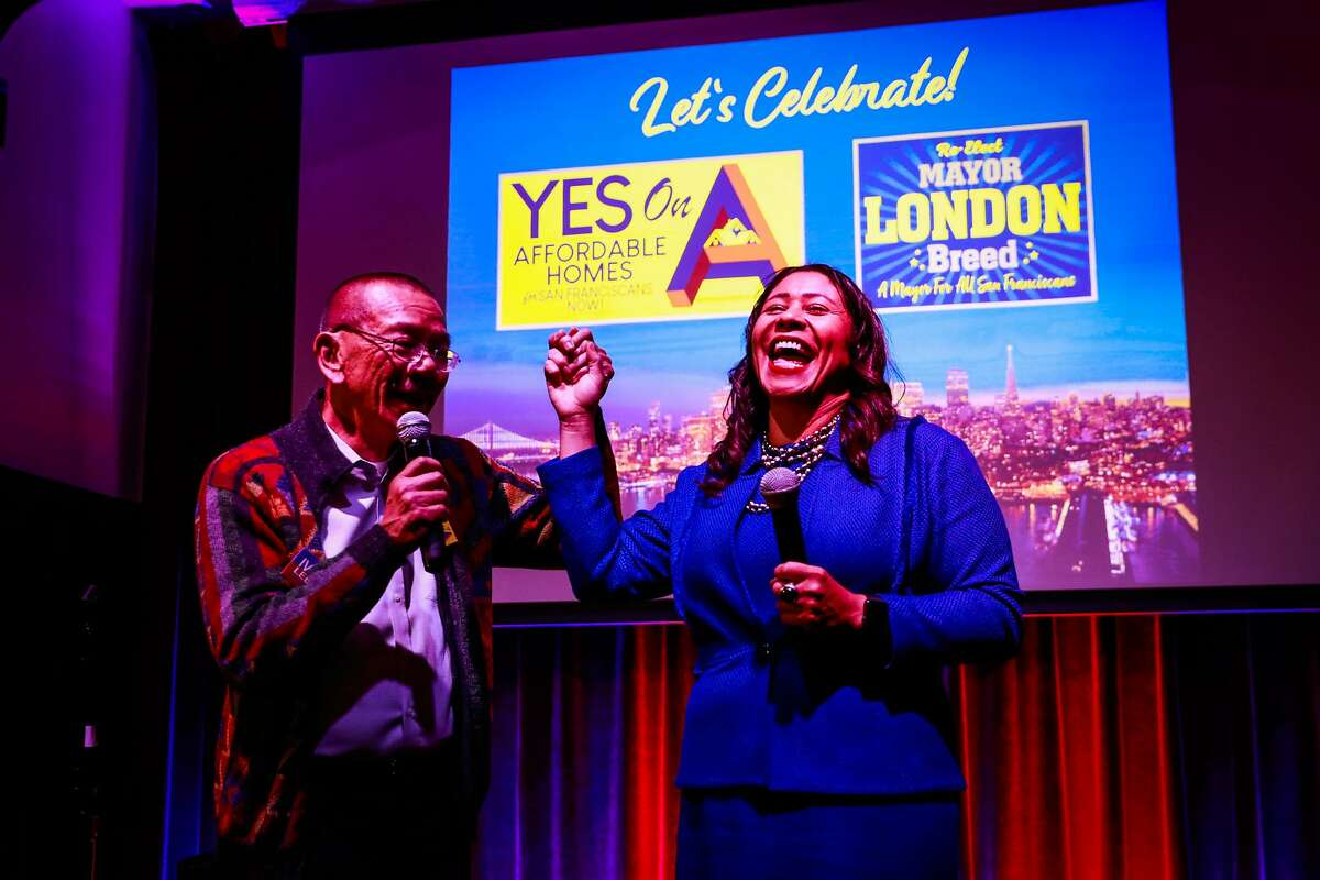 Supervisor Norman Yee cheers alongside Mayor London Breed at her election party at the Swedish American Hall in San Francisco, California, on Tuesday, Nov. 5, 2019.