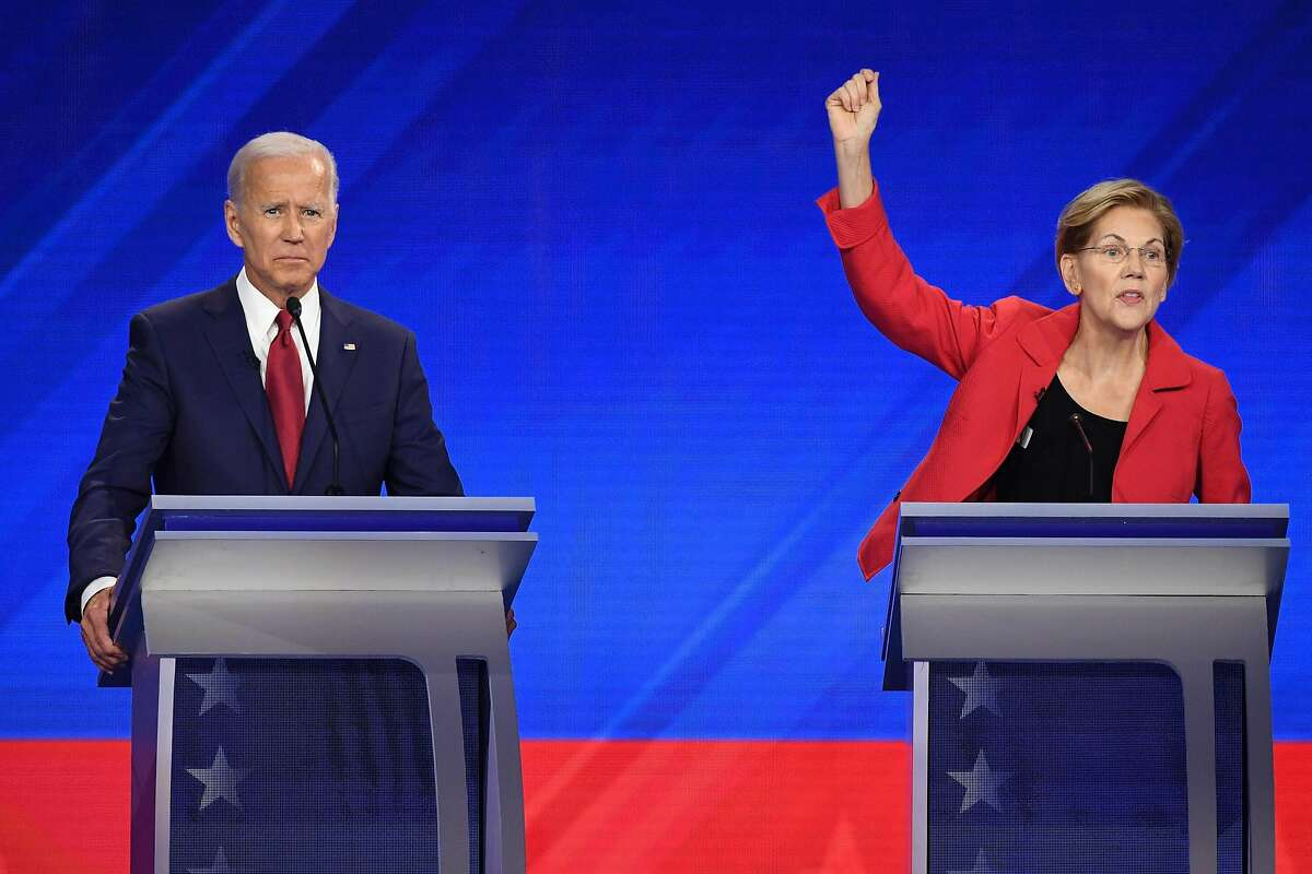 (FILES) In this file photo taken on September 12, 2019 Democratic presidential hopefuls Former Vice President Joe Biden (L) and Massachusetts Senator Elizabeth Warren participate in the third Democratic primary debate of the 2020 presidential campaign season hosted by ABC News in partnership with Univision at Texas Southern University in Houston, Texas. - US Democratic presidential candidate Elizabeth Warren has squeezed ahead of long-time front-runner Joe Biden for the first time, according to compiled polls released October 8, 2019. The RealClearPolitics poll average put Warren on 26.6 percent and Biden on 26.4 percent in the Democratic primary contest to take on President Donald Trump in the 2020 election. (Photo by Robyn BECK / AFP) (Photo by ROBYN BECK/AFP via Getty Images)