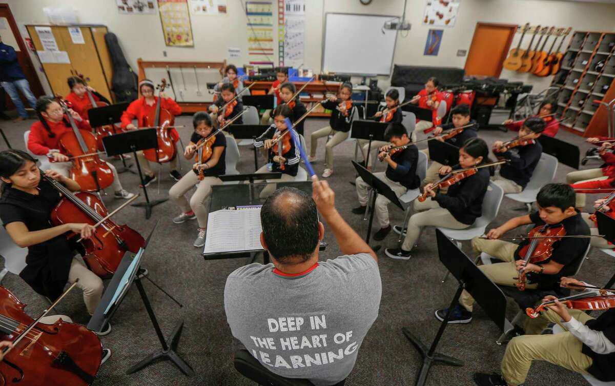 Pilgrim Academy orchestra conductor Mario Garcia leads his students at the Houston ISD campus on Wednesday, Oct. 30, 2019. The west side school boasts many enrichment and extracurricular activities, from music to chess to kickball, that campus leaders say contributes to academic success.