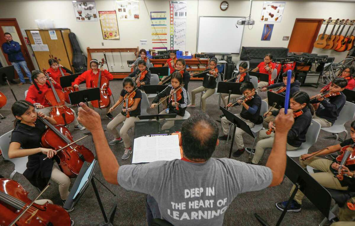 Pilgrim Academy orchestra conductor Mario Garcia leads his students at the Houston ISD campus on Wednesday, Oct. 30, 2019. Garcia has multiple relatives enrolled at the westside campus, where students from low-income backgrounds score above district averages on state standardized tests.