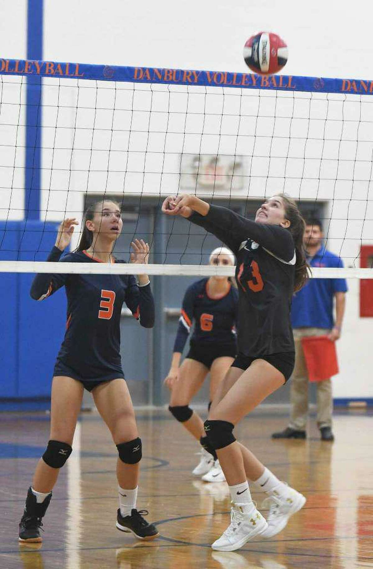 Isabel Voellmicke (#13) and the Ridgefield girls volleyball team qualified for the Class LL state tournament by beating Danbury, 3-1, in the final regular-season match last Friday. Voellmicke had11 assists and 11 service points (six aces) for the Tigers, who are 8-10 this year. Catherine Maguire added 14 kills and four blocks, while Mathilde Verbitsky contributed 13 kills and Julia Kocsis had six kills, 10 digs, and eight service points.