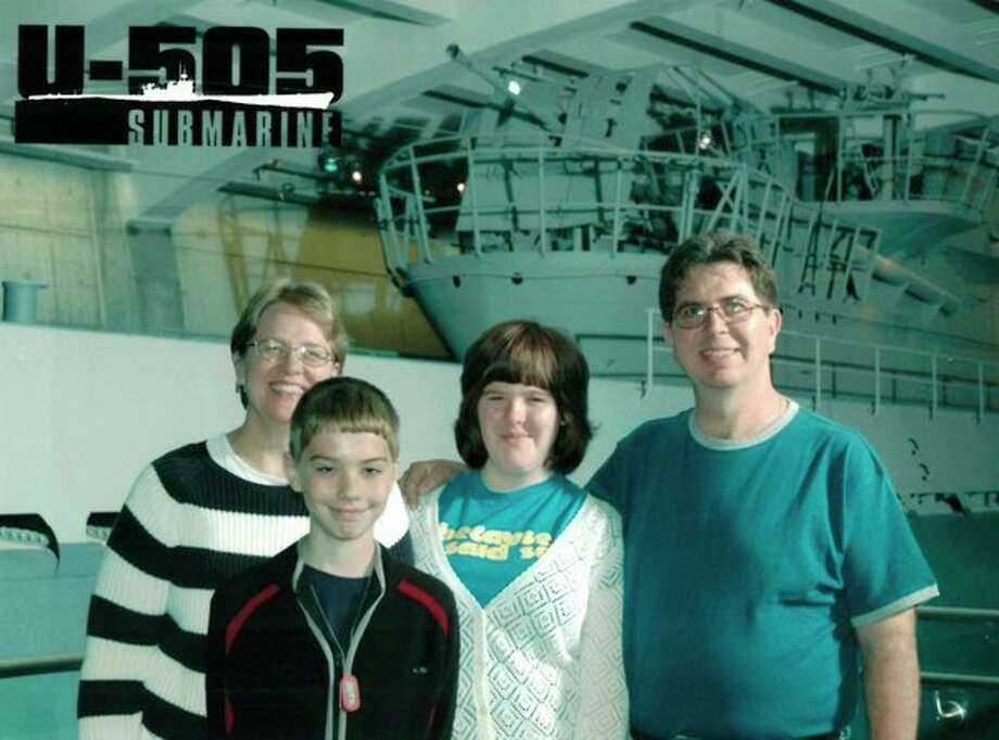 The Erkkila family is photographed at the Chicago Museum of Science and Technology. In the back row are Chris; daughter, Karen; Bob; and in front is their son, Kevin.