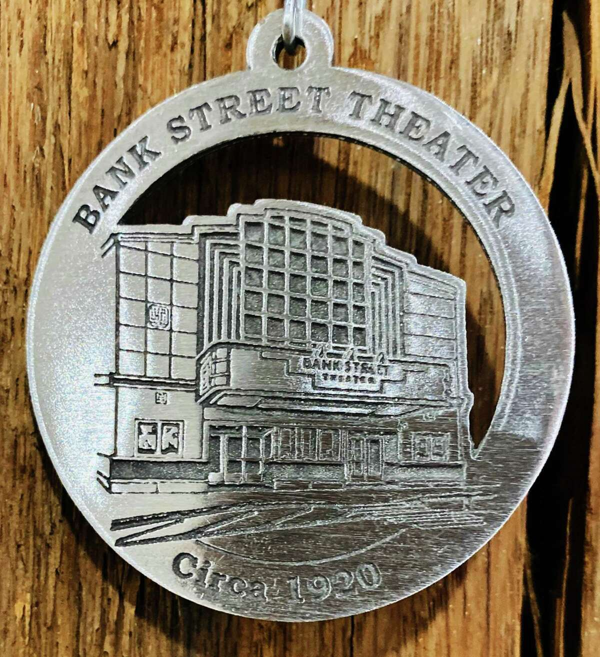 The New Milford Historical Society & Museum's 2019 commemorative medallionfeatures an image of the iconic Bank Street Theater