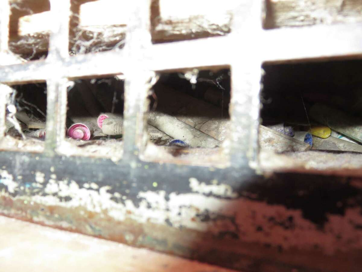 Used pens and other garbage can be seen through the vent in a Ridgefield school.