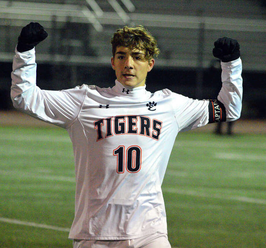 Edwardsville senior Jakob Doyle raises his hands in celebration after his assist set up the eventual game-winning goal by Cooper Nolan on Tuesday against Lincoln-Way West in the Class 3A Bradley-Bourbonnais Super-Sectional. Photo: Scott Marion/The Intelligencer