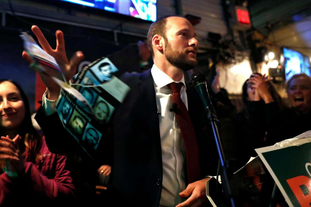 SF District Attorney candidate Chesa Boudin tears up and throws away an attack ad during speech at election night party at SOMA StrEat Food Park in San Francisco, Calif., on Tuesday, November 5, 2019.
