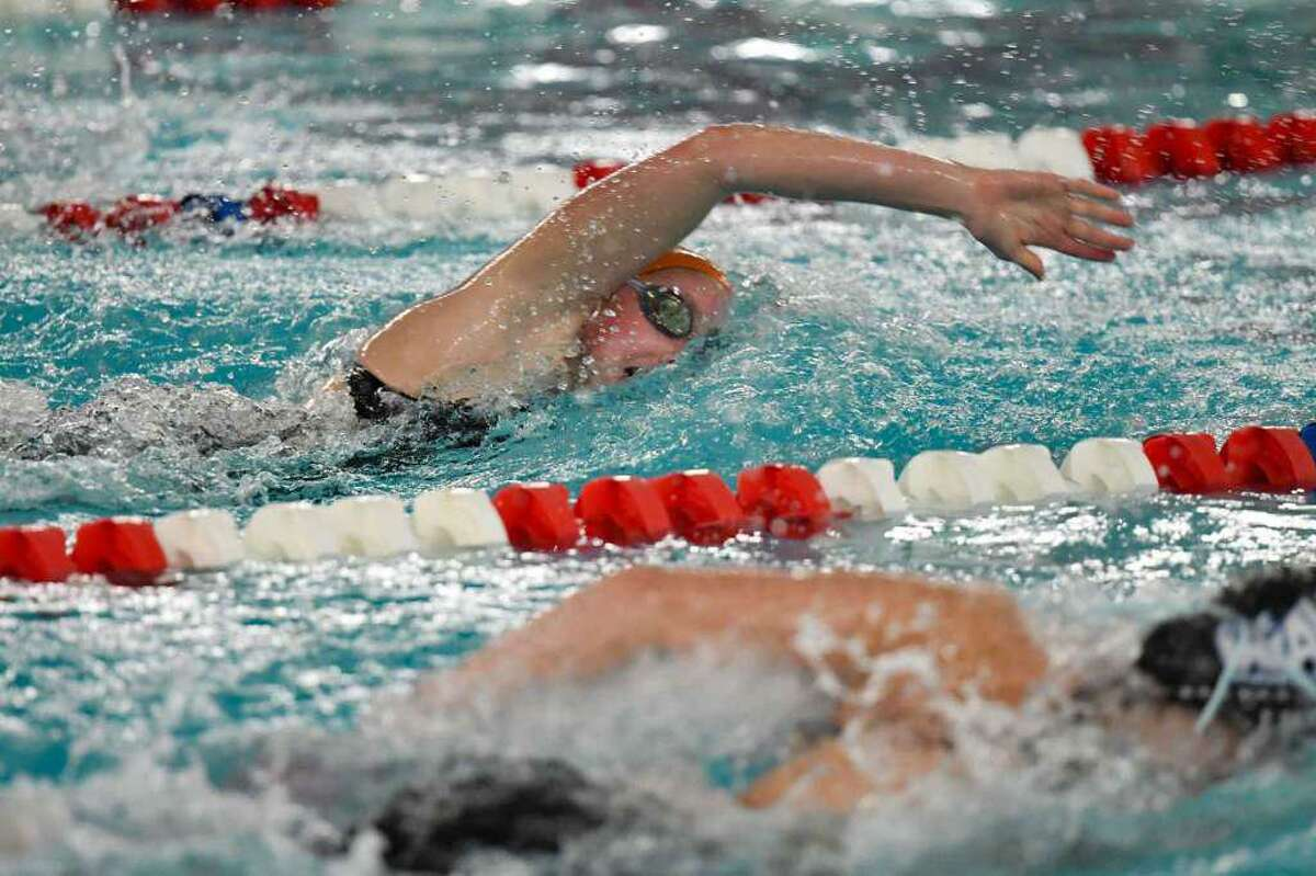 Ridgefield's Rylie Giles competes in the 200-yard freestyle at the FCIAC girls swimming championship meet Tuesday in Greenwich. Giles finished first in the event and also won the 500 freestyle.