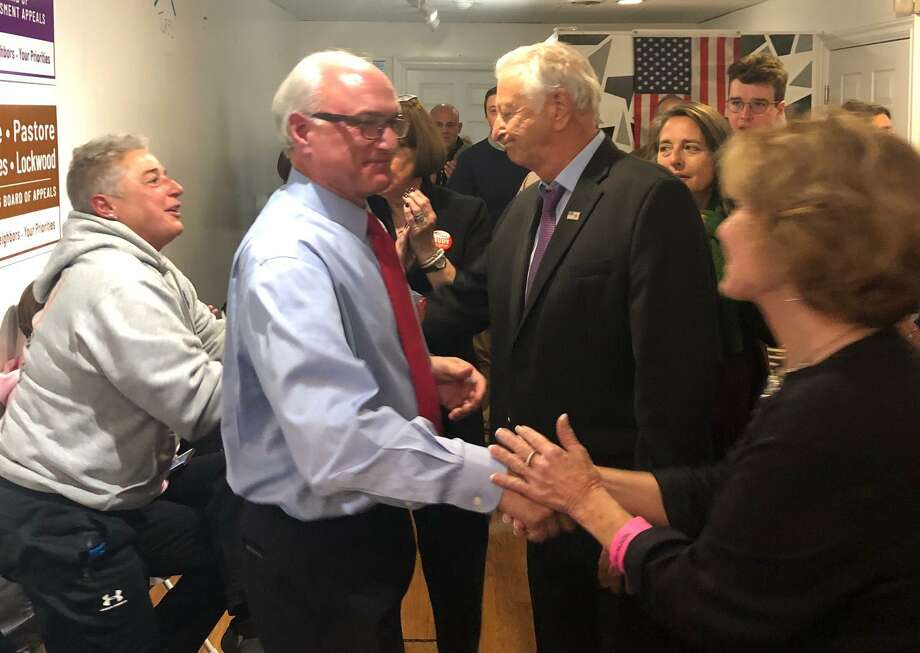 Ridgefield First Selectman Rudy Marconi, left, shakes hands with Republican challenger Dick Moccia and Ridgefield Republican Town Committee Chair Hope Wise on Tuesday, Nov. 5. Marconi won reelection, 5,099 votes to 2,592. Photo: Betsy Brand / Contributed Photo