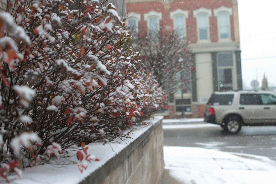 Here are scenes from around the city of Big Rapids as the snow falls on Wednesday. A winter weather advisory is in effect until 7 p.m. tonight. Photo: Pioneer Photo/Bradley Massman