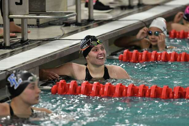 Lexi Punishill of the Darien Blue wave reacts after winning the 100yd Freestyle during the FCIAC Girls Swimming Championship on Tuesday9 at Greenwich High School.