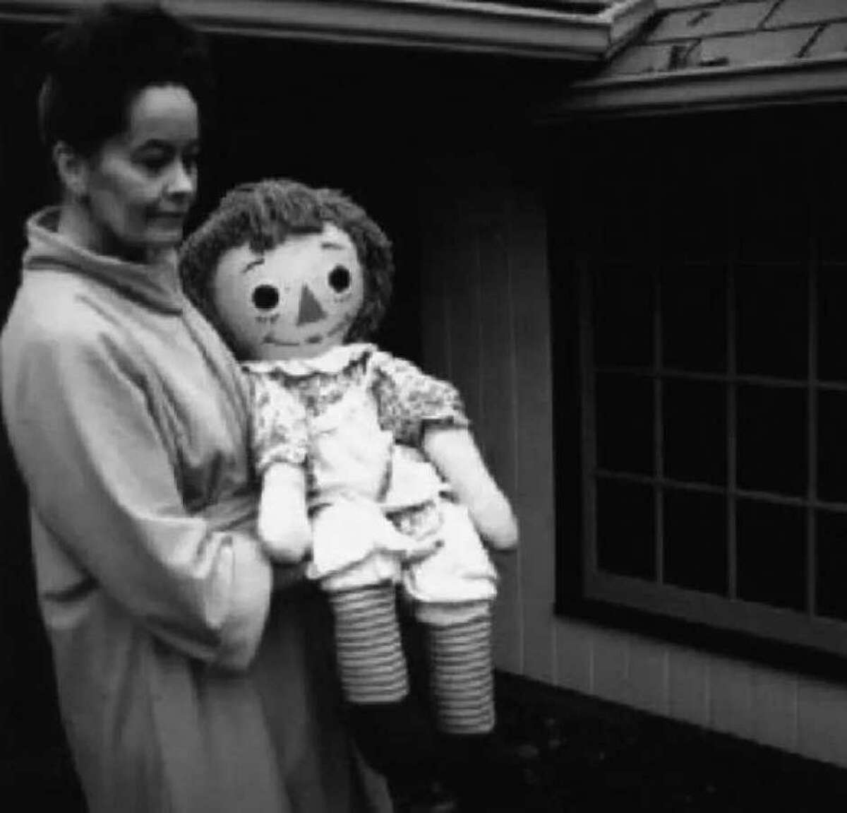 Lorraine Warren holds Annabelle, the Raggedy Ann doll displayed at the Warren's Occult Museum, in Monroe.