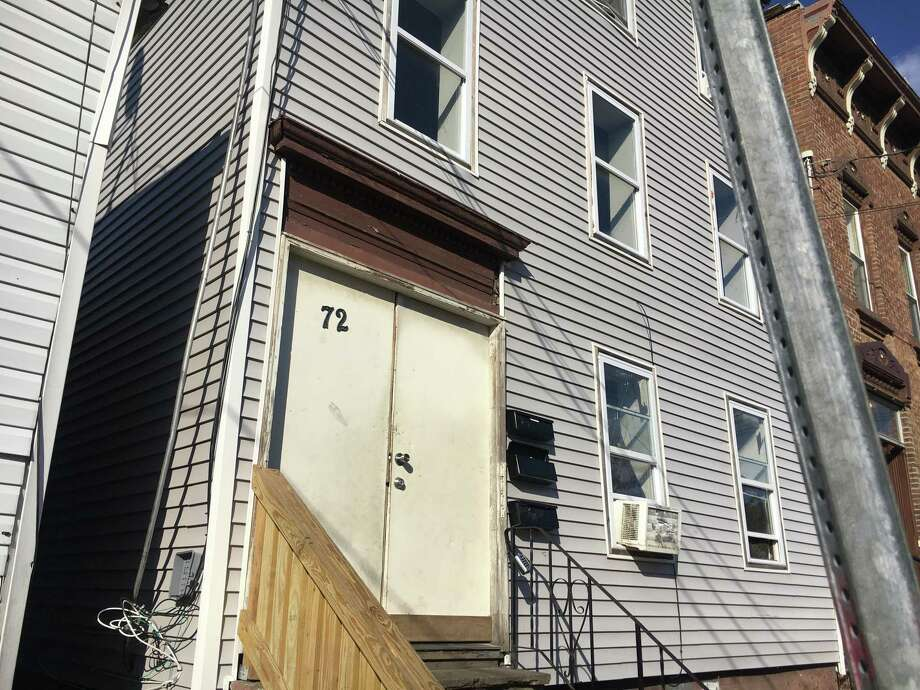 A property owned by the Hussain family at 72 13th Street in Troy that has been repeatedly hit with code violations by the city. Photo: By Larry Rulison