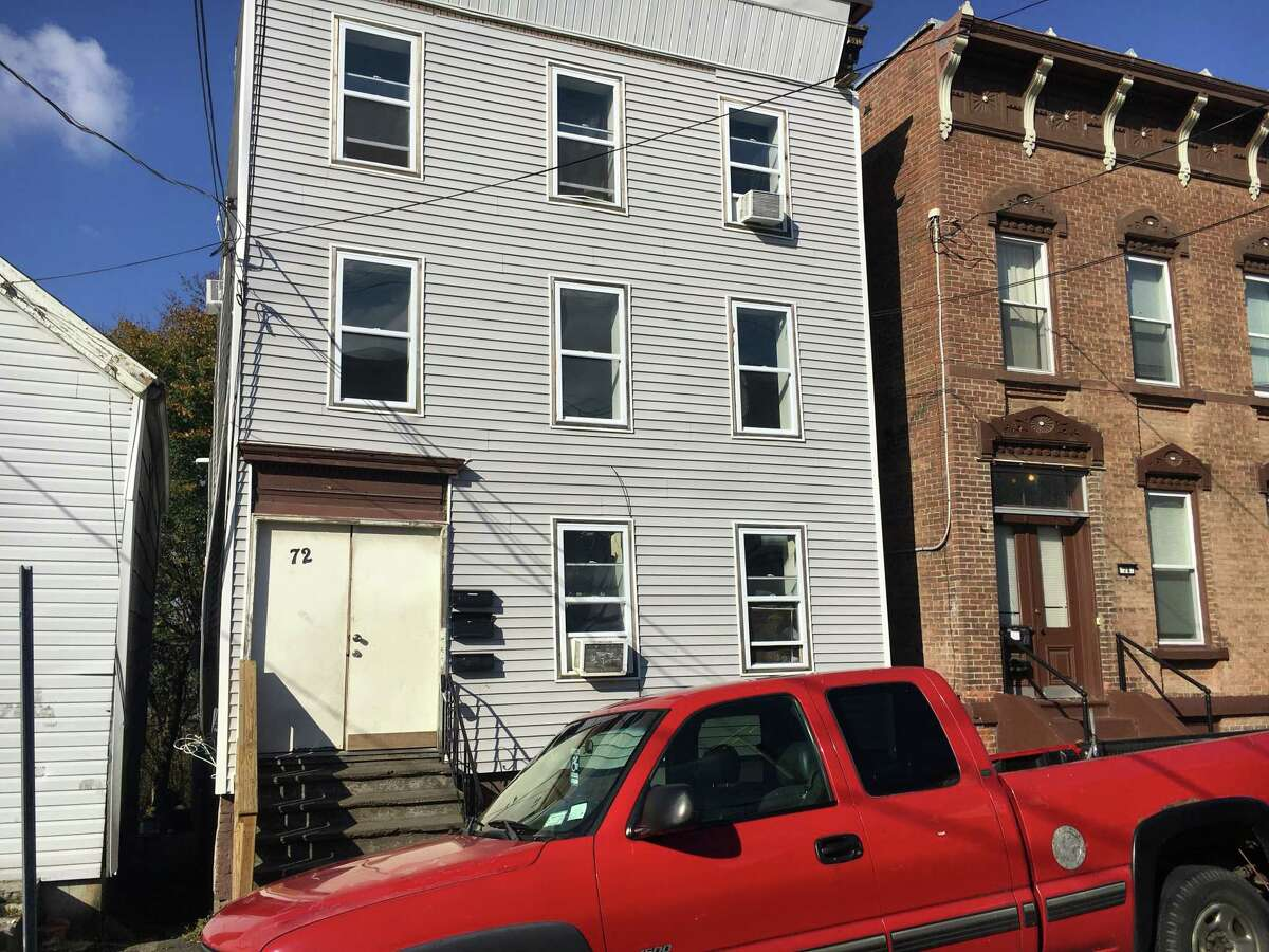 The Hussain family owns this apartment building next to Rensselaer Polytechnic Institute at 72 13th Street in Troy. The city has repeatedly cited the building for code violations.