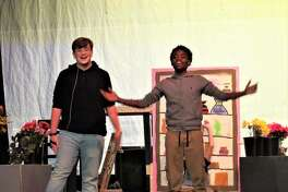 """Cast members rehearse Alton Middle School's musical """"Little Shop of Horrors."""""""
