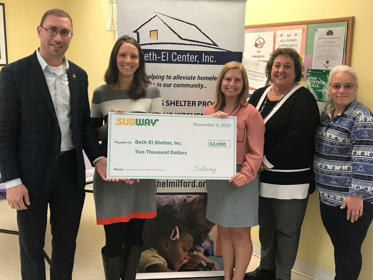 Subway presented a check and gift cards to the Beth-El Center in Milford to subsidize their new No Freeze winter shelter breakfast program. Victor Lamberti, Subway manager of community engagement; Jenn Paradis, Beth-El Center executive director; Shannon McMahon, Subway public relations specialist; Michele DiNello, Subway vice president of public relations, communications, and events; and Camille Franchi, Beth-El Center soup kitchen manager.