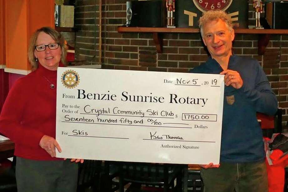 Sunrise Rotary Foundation's Treasurer Phyllis Kladder presented a symbolic check to Tim Furbacher of the Crystal Community Ski Club. (Courtesy Photo)