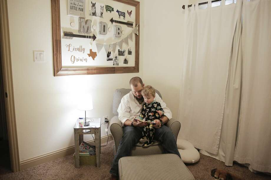 Dillon Bright reads to his son, Mason, before putting him to bed. Photo: Elizabeth Conley,  Staff Photographer / ? 2019 Houston Chronicle USE ONLY IN DO NO HARM: This image may not be resold. No archive. No standalone internet. No social med