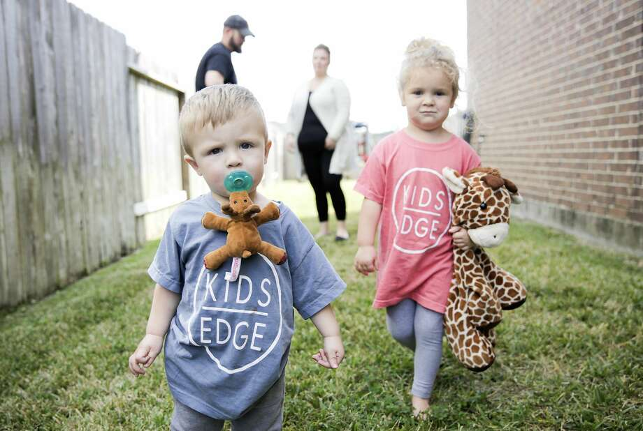 Mason and Charlotte outside their Tomball home. Photo: Elizabeth Conley,  Staff Photographer / © 2019 Houston Chronicle USE ONLY IN DO NO HARM: This image may not be resold. No archive. No standalone internet. No social med