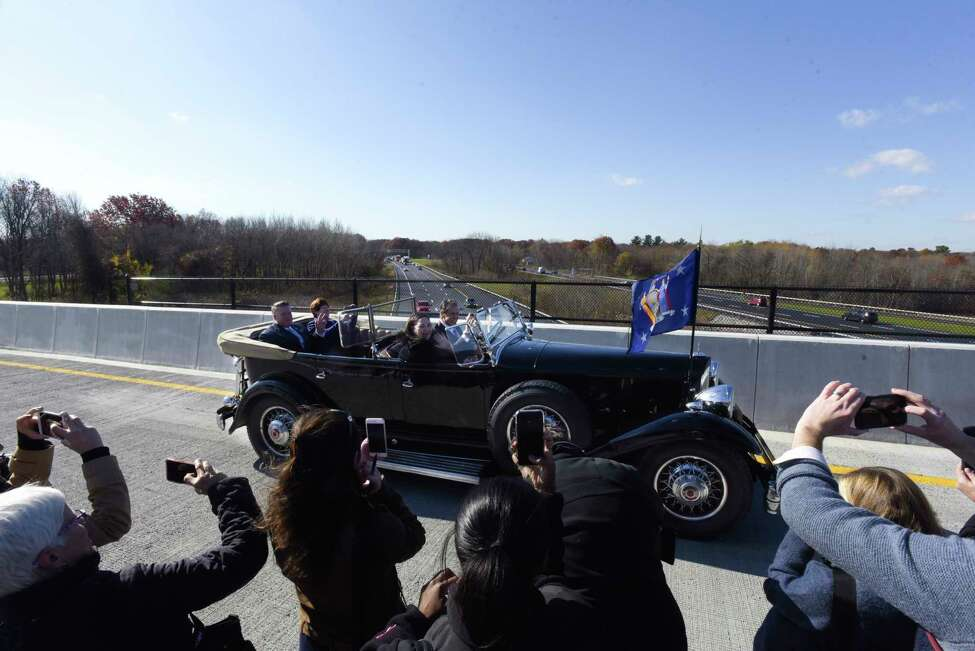 Governor Andrew Cuomo drives FDR's Packard with Marie Therese Dominguez, Commissioner of DOT, Albany County Executive Dan McCoy, and Albany Mayor Kathy Sheehan, over the finished flyover for the new exit 3 off of Interstate 87, on Wednesday, Nov. 6, 2019, in Colonie, N.Y. (Paul Buckowski/Times Union)