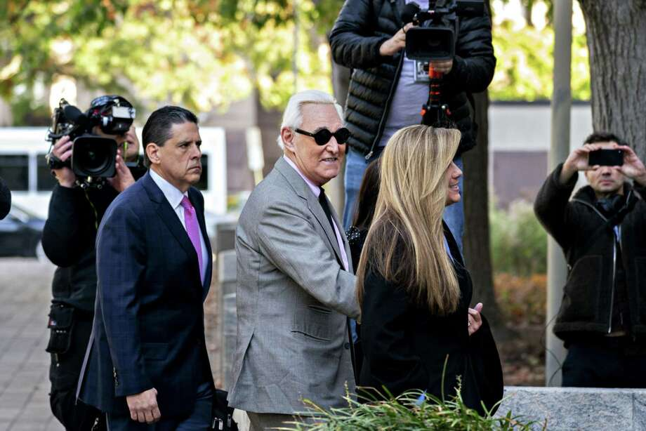 Roger Stone, former adviser to Donald Trump's presidential campaign (center) arrives at federal court in Washington on Nov. 5, 2019. Photo: Bloomberg Photo By Andrew Harrer. / © 2019 Bloomberg Finance LP
