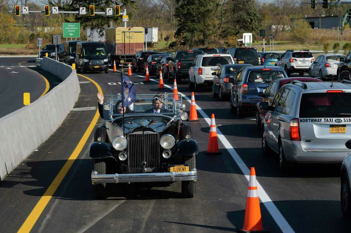 Governor Andrew Cuomo drives FDR's Packard with Marie Therese Dominguez, Commissioner of DOT, Albany County Executive Dan McCoy, and Albany Mayor Kathy Sheehan, over the finished flyover for the new exit 3 off of Interstate 87, on Wednesday, Nov. 6, 2019, in Colonie. The new ramp is part of improvements at and around Albany International Airport.(Paul Buckowski/Times Union)